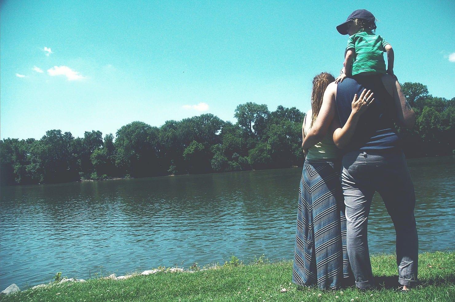 Family looking at a lake