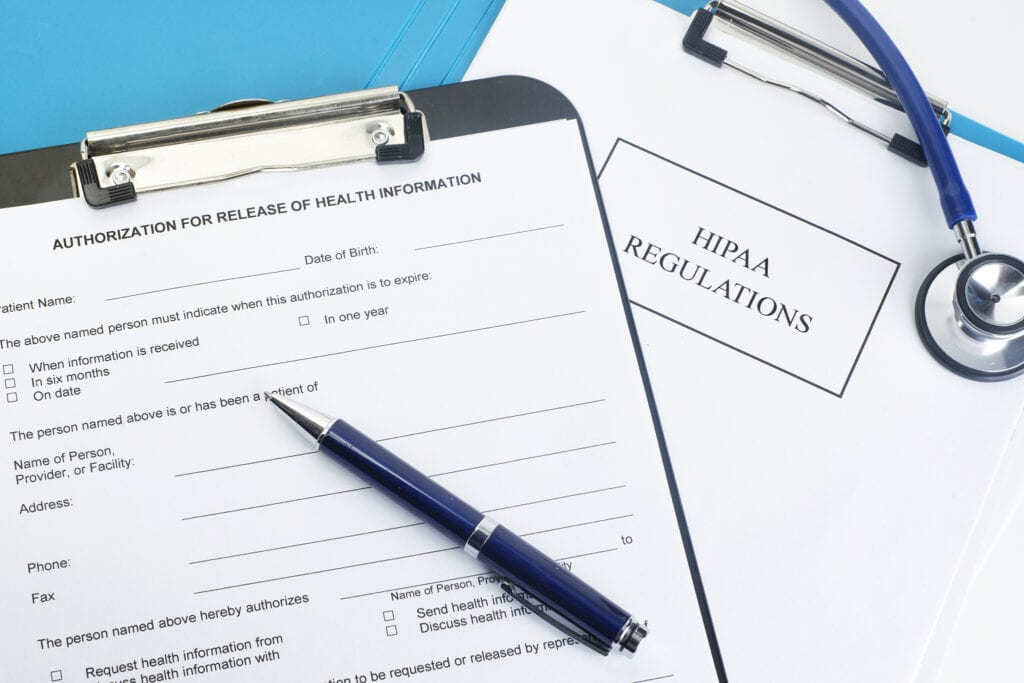Patient release of information form with HIPAA regulations documents